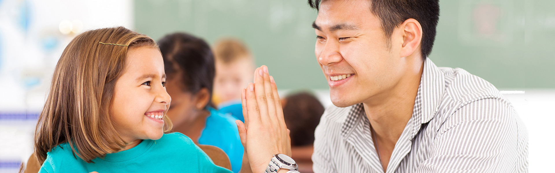 paraeducator and student high five
